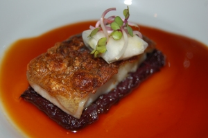 Morey eel with crispy skin, red cabbage and sardine in red wine juice