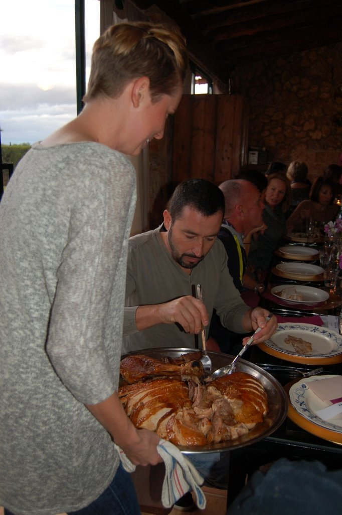 Joanna offers turkey to one of the two owners of the venue