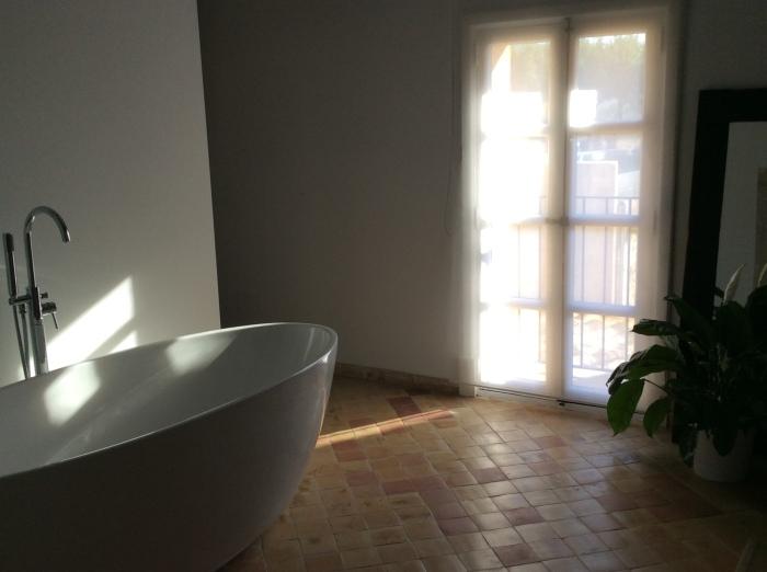 A leisurely soak awaits in the suite's huge bathroom.