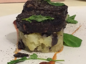 Lancashire black pudding on a bed of rosemary and olive potatoes, with Bloody Mary ketchup