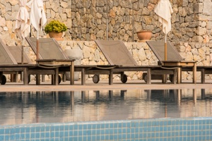 Loungers by pool of Son Brull Hotel and Spa