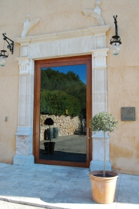 The impressive glass door into Son Brull Hotel and Spa