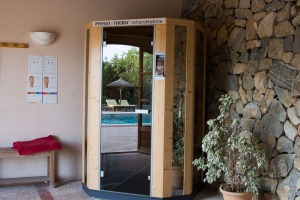 The pool reflected in the door of the infrared sauna.