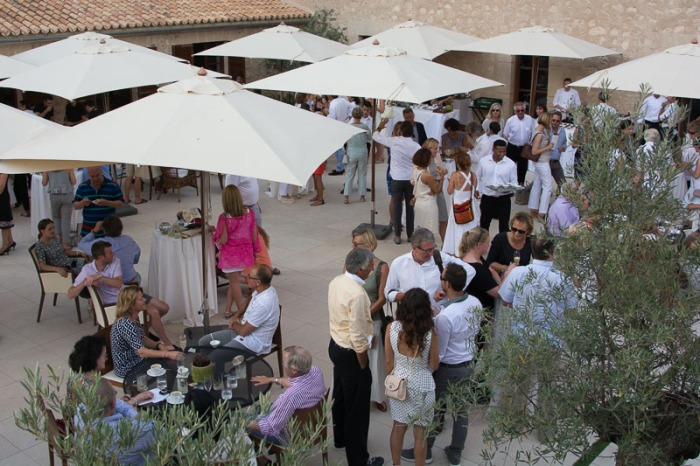 Guests gathering on the terrace for desserts.