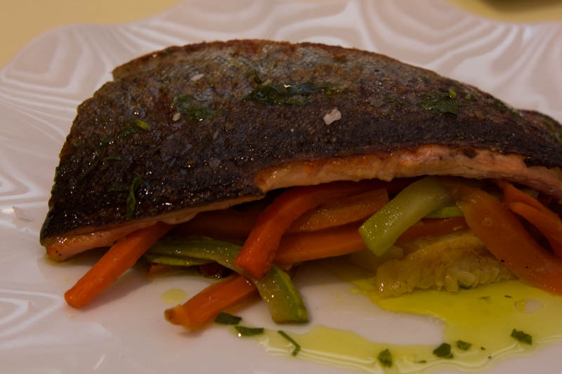 Perfectly cooked fillet of trout with vegetables.