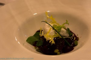 Beetroot salad with crumbled goat's cheese, beetroot cream and balsamico.
