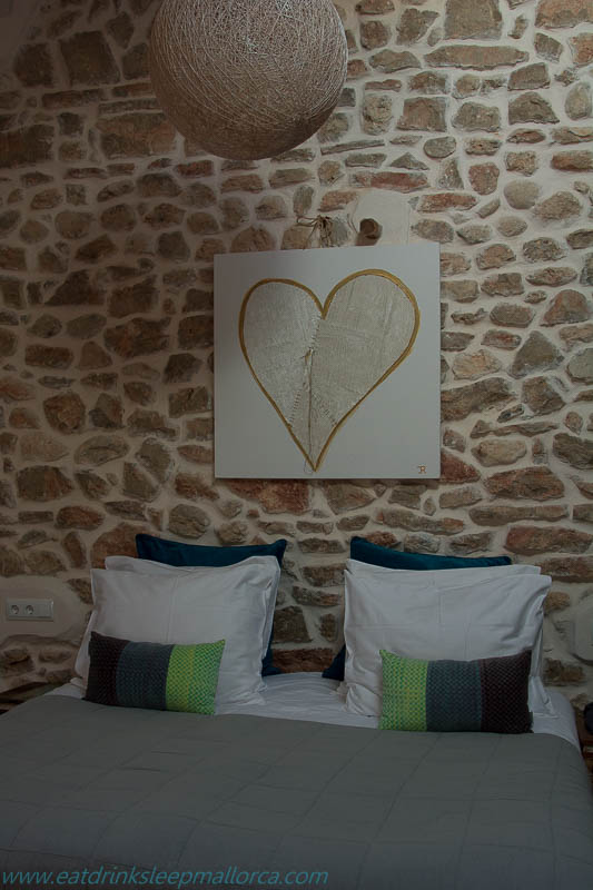 Art by Jacqueline over our bed. Note the attractive typical exposed stone walls that are a feature of the hotel.