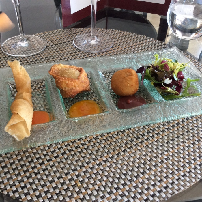 L-R Crunchy sole roll with tomato and ginger sauce; crunchy ravioli of pork cheek with mango and sweet chilli sauce, and goat's cheese and walnut 'croqueta'.
