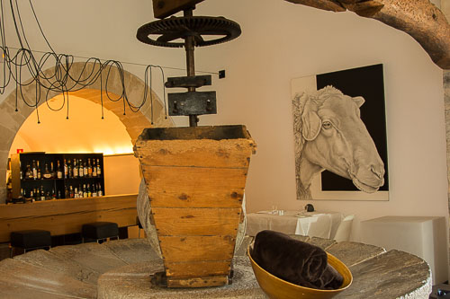 Old olive press in the bar at Son Brull Hotel & Spa