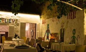 Al fresco terrace with quirky art on the walls
