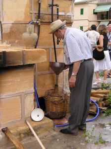 Myrtle liqueur being made at Selva Herb Fair