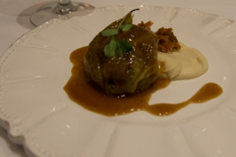 Pork wrapped in cabbage with a cauliflower puree