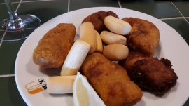 Tasty battered cod, served with mini-breadsticks.