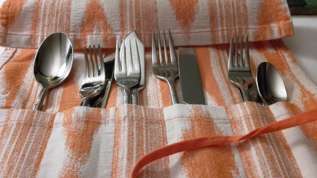 Cutlery presented in a roll