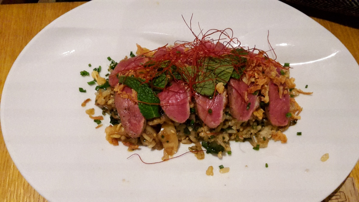 Main course on lunch menu of Japanese crispy rice with duck breast