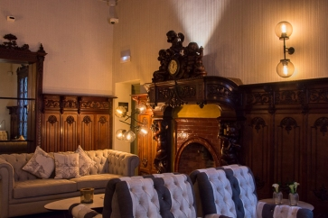 Club room with original fireplace (with built-in clock)