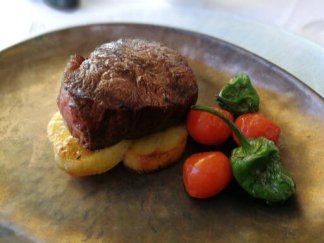 Tender fillet steak cooked to perfection and served with potatoes, roasted tomatoes and Padron peppers