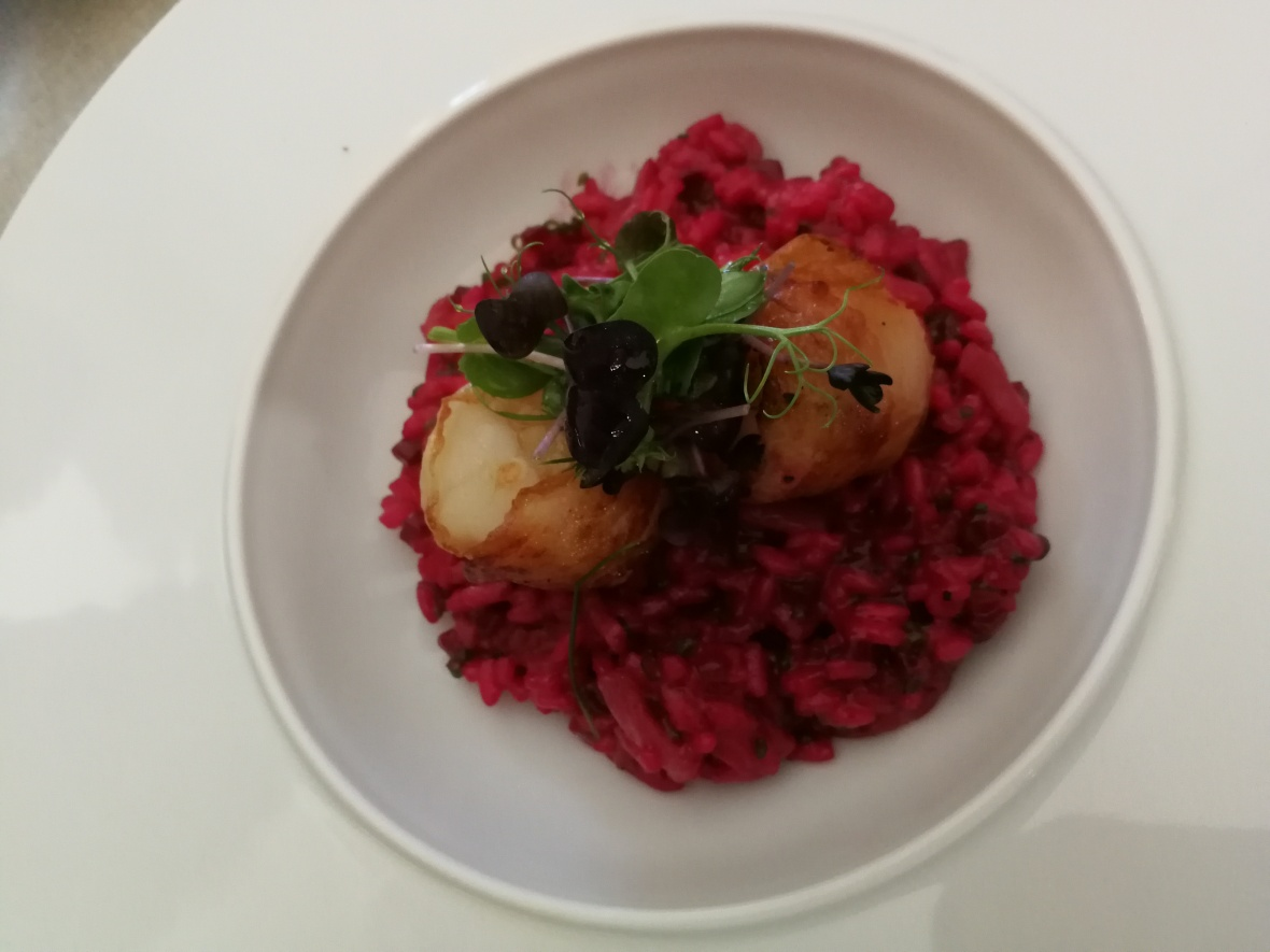 Scallops on a bed of beetroot risotto