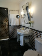 Elegant bathroom of room 37 at Hotel Cappuccino