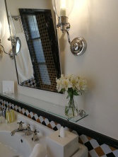 Fresh flowers in the elegant bathroom