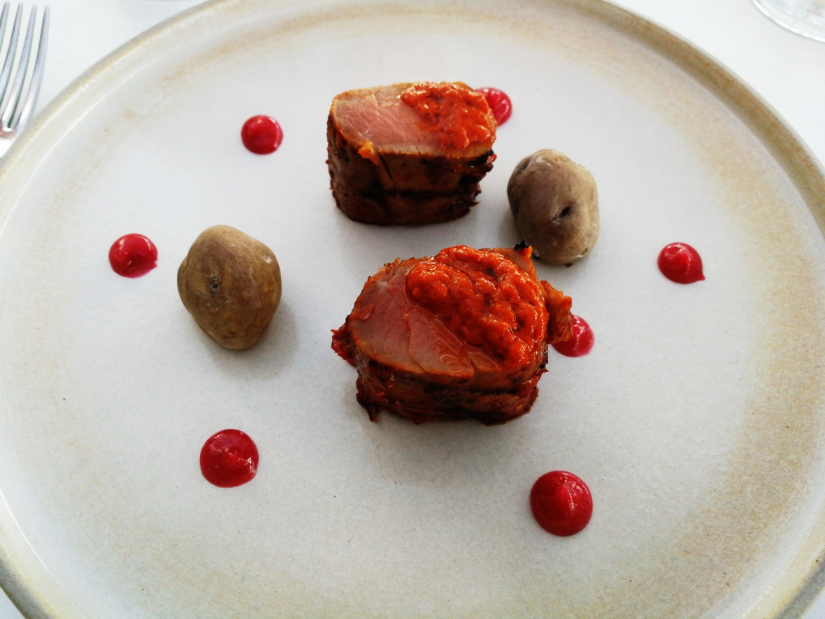 Braised pork fillet with mojo picon, cranberry jelly, and papas bonitas
