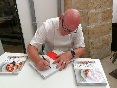 Marc Fosh signs copies of his book