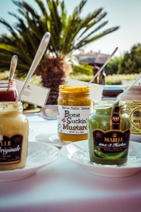 Just a few of the mustards, sauces, and relishes to enjoy with the BBQ (this photo courtesy of the hotel)