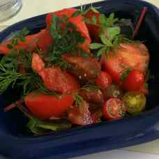 A delicious organic tomato and herb salad