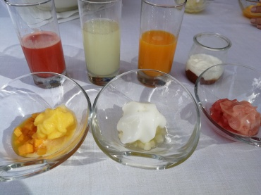 Starting breakfast with juices, fruits, and yogurt