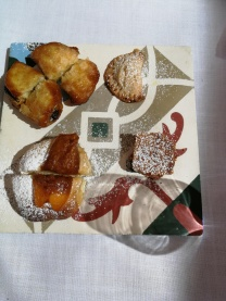Mallorcan sweet pastries to end the breakfast, served on a Huguet (Campos) tile